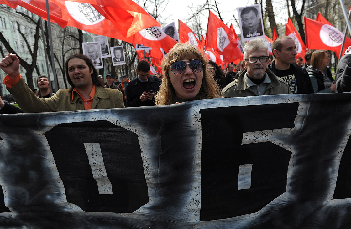 Members of leftist opposition groups take part in their traditional May Day rally in Moscow on May 1, 2013, with leftist leader and writer Eduard Limonov (2nd R) attending.