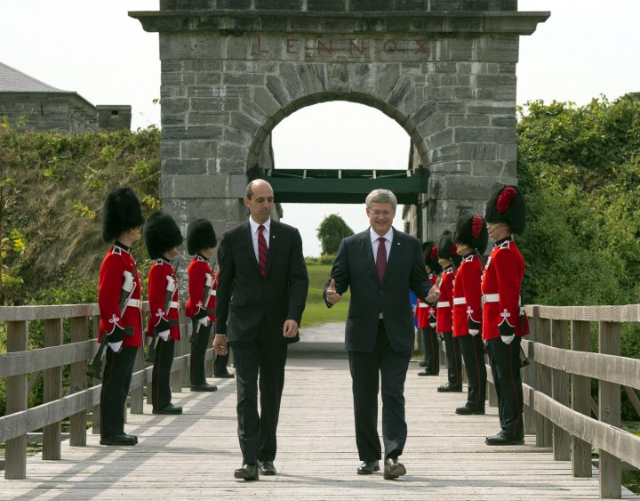 Prime Minister Stephen Harper, right, and Veteran's Affairs Minister Steven Blaney walk past an honour guard at Fort Lennox Friday, September 14, 2012 in Saint-Paul-de-L'ile-aux-Nois. Harper commemorated the war of 1812.