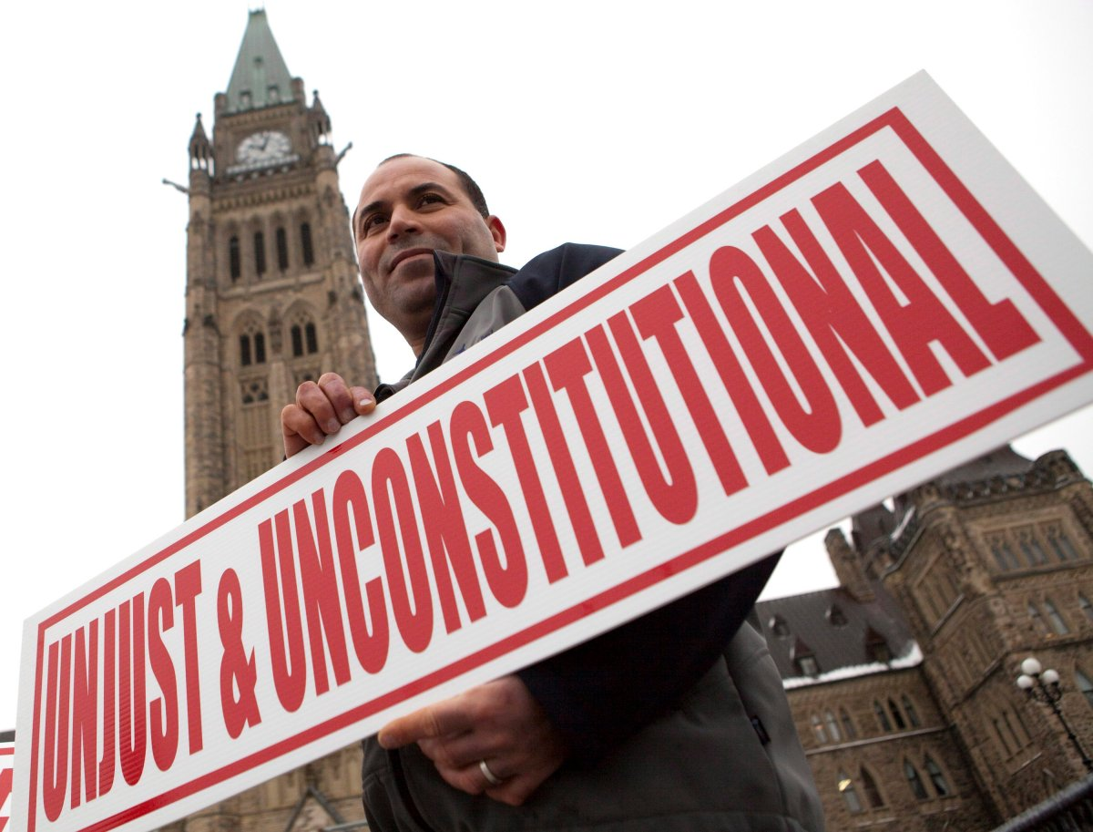 ohamed Harkat participates in a rally on Parliament Hill marking the 10th anniversary of his arrest and detention on a security certificate, Monday, Dec. 10, 2012, in Ottawa.