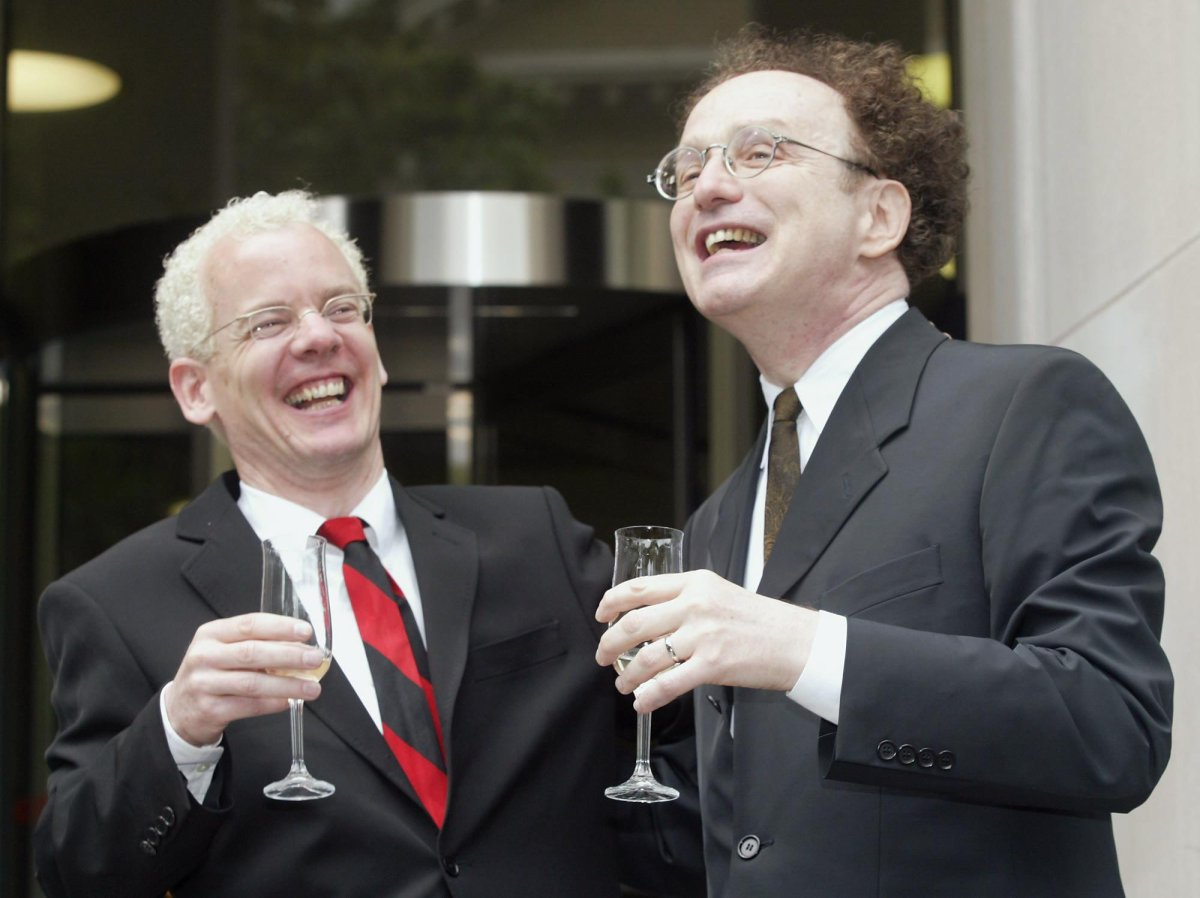 Michael Stark (left) and Michael Leshner celebrate with champagne after their marriage in Superior Court in Toronto on Tuesday, June 10, 2003. The couple have been together for 22 years and were finally allowed to marry following a court ruling Tuesday morning.
