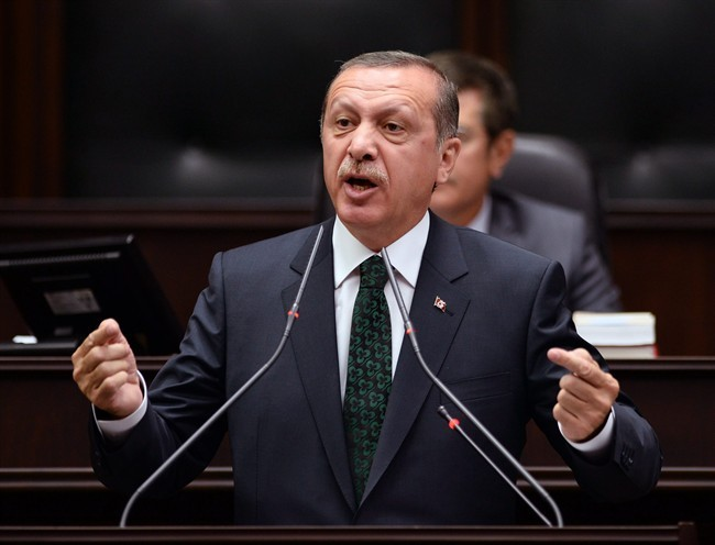 Turkish Prime Minister Recep Tayyip Erdogan addresses his supporters and lawmakers at the parliament in Ankara, Turkey, Tuesday, June 25, 2013.