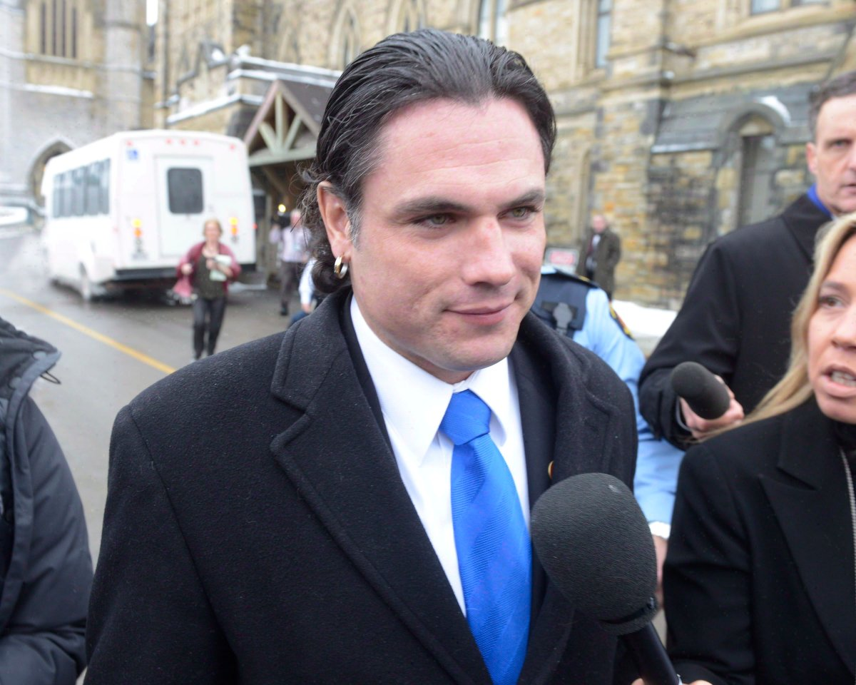 Sen. Patrick Brazeau talks to media on Parliament Hill in Ottawa, Tuesday, Feb.12, 2013. The RCMP says it is examining Senate expense claims following an independent audit and a critical report from the upper chamber's internal economy committee.THE CANADIAN PRESS/Adrian Wyld.