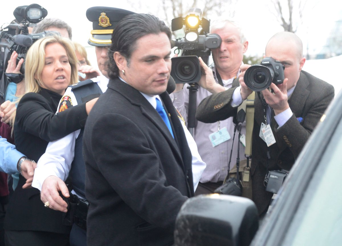 Sen. Patrick Brazeau enters a vehicle on Parliament Hill in Ottawa, Tuesday, Feb.12, 2013. Senators have voted to force Brazeau, who is facing criminal charges, to take a leave of absence from the upper chamber.THE CANADIAN PRESS/Adrian Wyld.