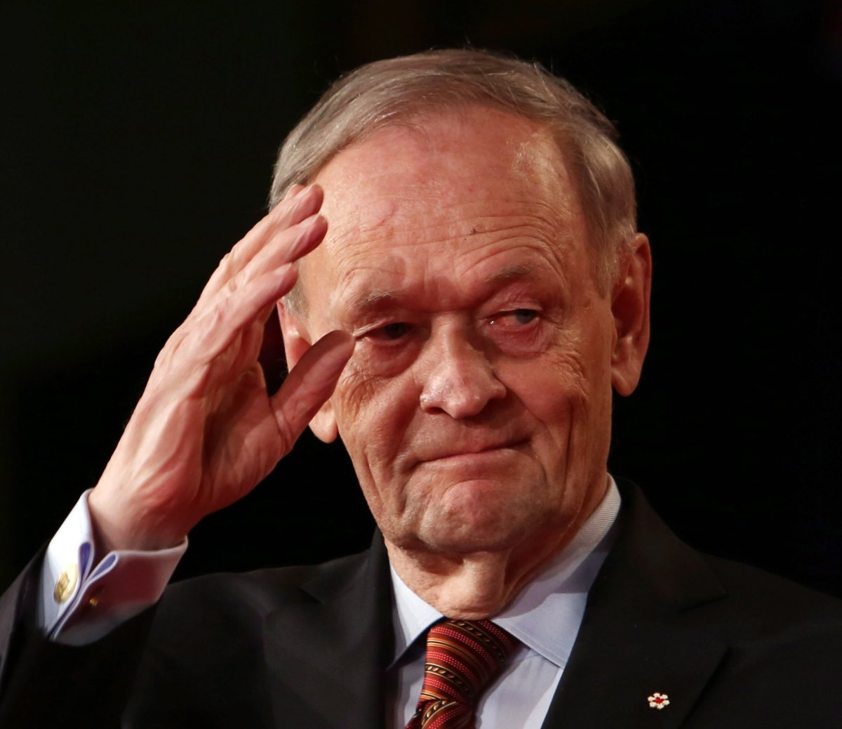 Former prime minister Jean Chretien saluts after addressing the Liberal Party leadership in Ottawa, Sunday April 14, 2013.