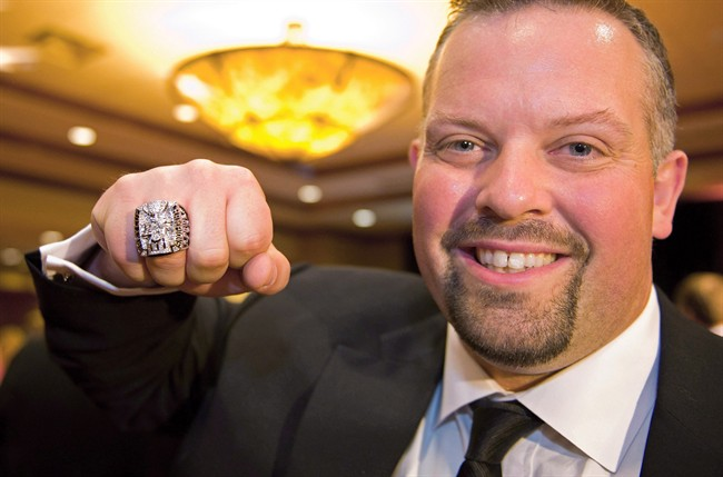 B.C. Lions Angus Reid shows off his 2011 Grey Cup ring in Richmond, B.C., on June 1, 2012.