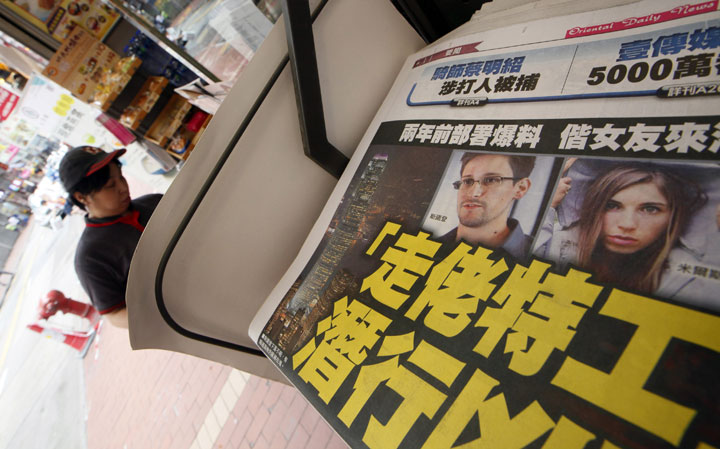 The picture of Edward Snowden, former CIA employee who leaked top-secret documents about sweeping U.S. surveillance programs, is displayed on the front page of a newspaper in Hong Kong Wednesday, June 12, 2013.