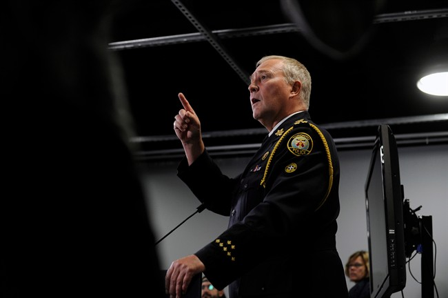 Toronto Police Chief Bill Blair holds a news conference in Toronto, Thursday, June 13, 2013. THE CANADIAN PRESS/Galit Rodan.