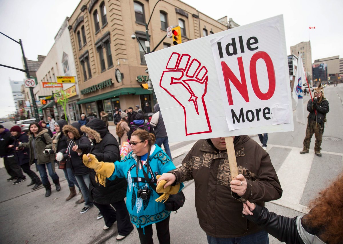 Demonstrators with the Idle No More movement block an intersection in downtown London Ontario, Thursday, March 21, 2013. THE CANADIAN PRESS/ Geoff Robins.