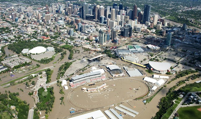 A flooded downtown Calgary is seen from a aerial view of the city Saturday, June 22, 2013. Many cite extreme weather events such as this as proof of climate change.