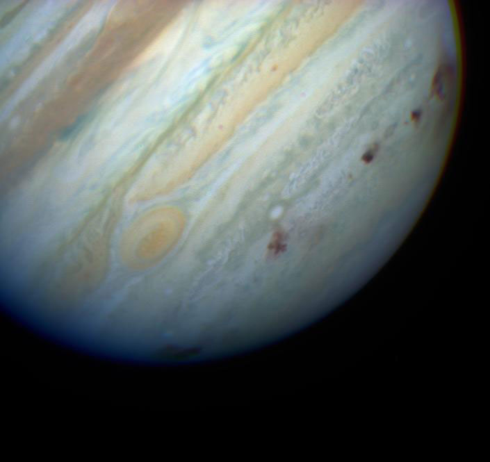 Comet Shoemaker-Levy 9 was torn apart by Jupiter's massive gravity. The pieces collided with the planet, leaving dark scars in the planet's cloud tops.