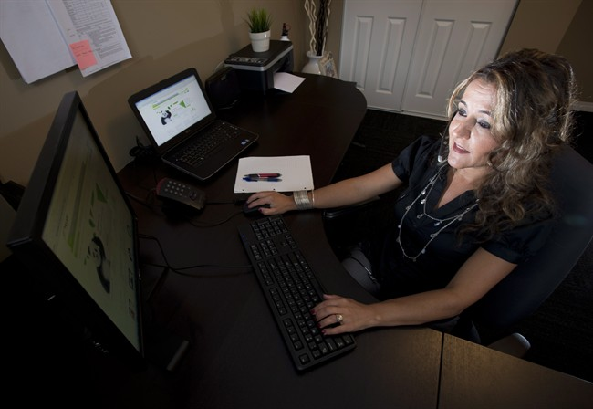 Ana Aresta works from her home in Delta, B.C. on Thursday, June 20, 2013.