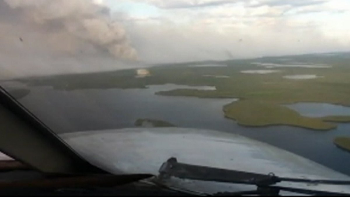 A fire burns near Ilford, in northern Manitoba, in early June. Fires in the region are expected to significantly impact air quality.