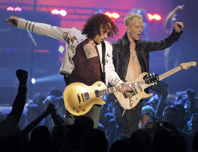 In a May 25, 2006, file photo Vivian Campbell, left, and Phil Collen, right, of rock group Def Leppard perform in Las Vegas.