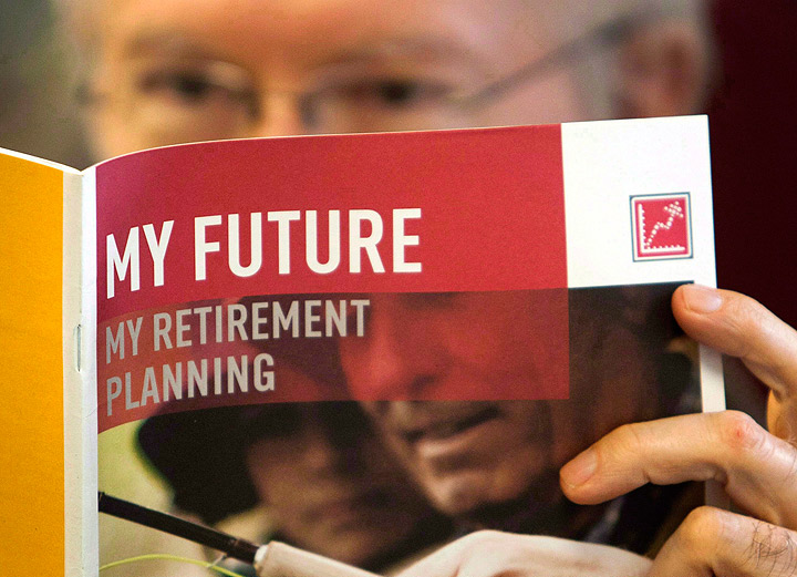 A man looks over a brochures offering various retirement savings options.