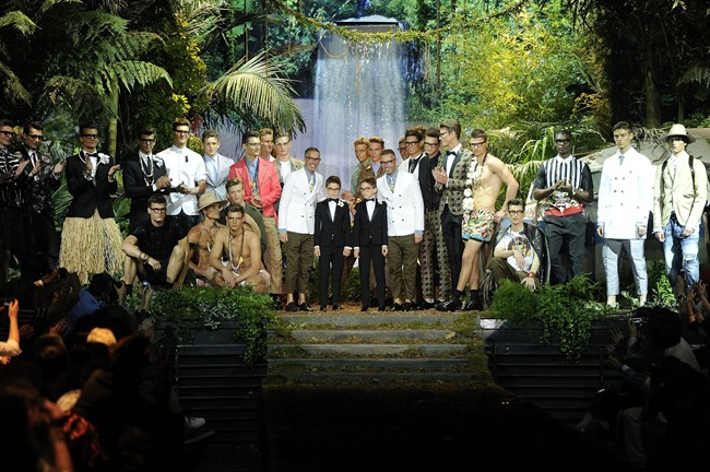 Fashion designers Dean and Dan Caten pose with models at the end of DSquared2 men's Spring-Summer 2014 collection, part of the Milan Fashion Week, unveiled in Milan, Italy, Tuesday, June 25, 2013.