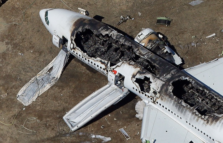 A Boeing 777 airplane lies burned near the runway after it crash-landed at San Francisco International Airport July 6, 2013 in San Francisco, California.