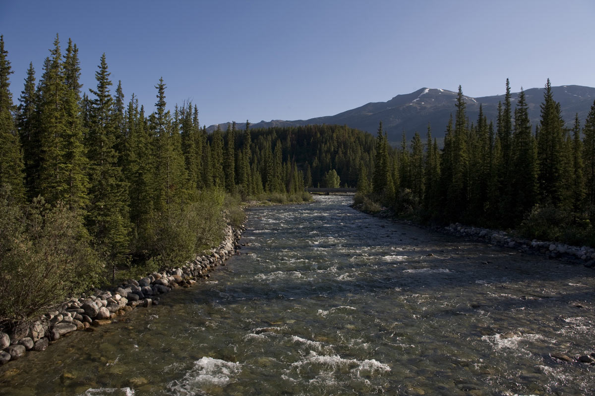 The Bow River flows through the valley as seen in this 2009 Lake Louise, Canada summer morning photo.