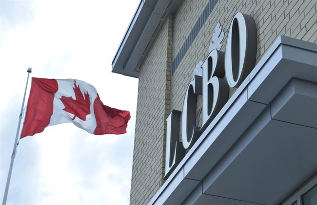 A Canadian flag flies at a LCBO store in Bowmanville, Ontario on Saturday July 20, 2013.