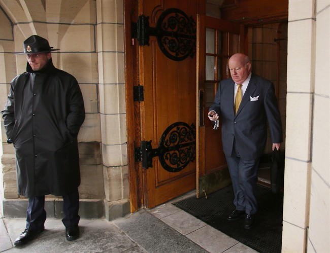 Conservative Senator Mike Duffy leaves Parliament Hill, in Ottawa, on June 6, 2013. THE CANADIAN PRESS/Fred Chartrand.