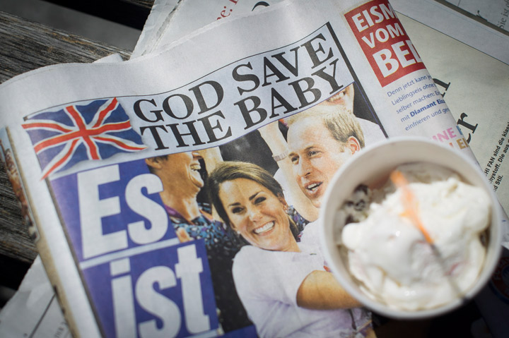 A newspaper headline reads 'God Save the Baby' the day after the birth of the son of Prince William, Duke of Cambridge and Catherine, Duchess of Cambridge on July 23, 2013 in Berlin.