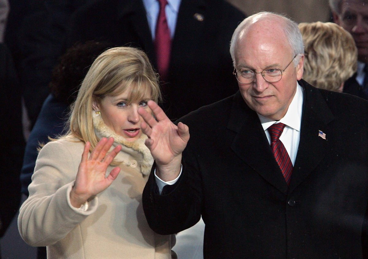 Former U.S.Vice President Dick Cheney (R) and his daughter Liz watch the inaugural parade from the Presidential reviewing stand in front of the White House January 20, 2005 in Washington, DC.