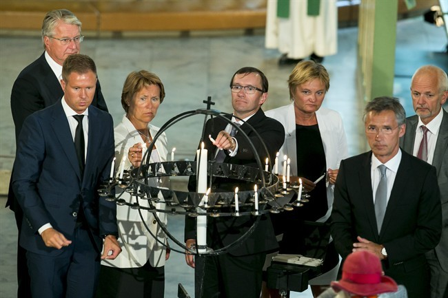 Left to right, AUF leader Eskil Pedersen, Minister of Defence Grete Farmo, Foreign Minister Espen Barth Eide, Minister of Government Affairs Rigmor Aasrud and Prime Minister Jens Stoltenberg light candles during the memorial service at Oslo Cathedral, two years after the terrorist attacks on 22 July 2011 in Oslo and on Utoya, Monday, July 22, 2013.