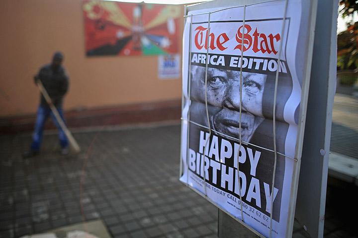 A newspaper flysheet declares 'Happy Birthday' to Nelson Mandela opposite Mandela's former home in Vilakazi Street, Soweto Township on July 18, 2013 in Johannesburg, South Africa.