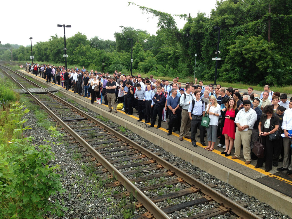 Hundreds waiting for a GO Train at Long Branch Mississauga station on July 9, 2013.