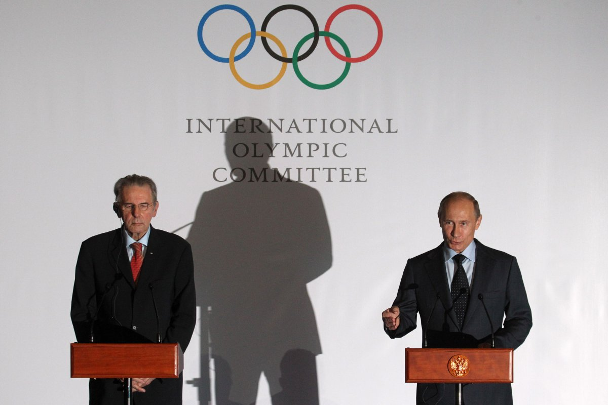 Russian President Vladimir Putin (R) speaks as International Olympic Committee (IOC) President Jacques Rogge listens during a presentation of the medals that will be awarded at the 2014 Winter Olympics in Sochi May 2013 in Saint Petersburg, Russia.  Sasha Mordovets/Getty Images.