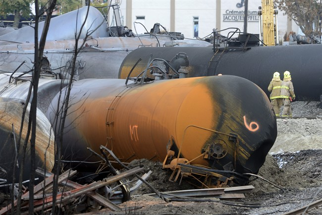 Work continues at the crash site of the train derailment and fire Tuesday, July 16, 2013 in Lac-Megantic, Que.