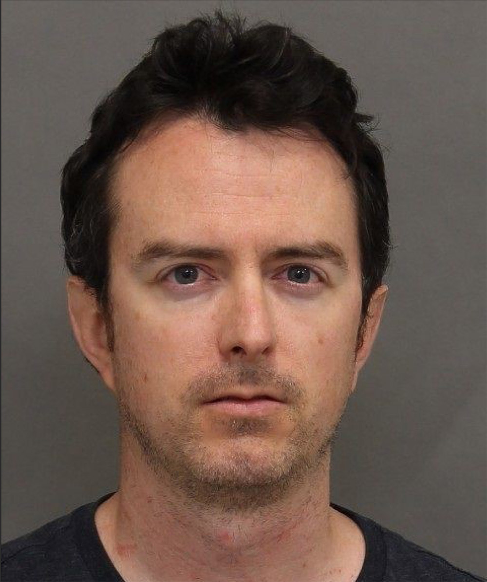 Paul Moore, 35, charged in voyeurism investigation.