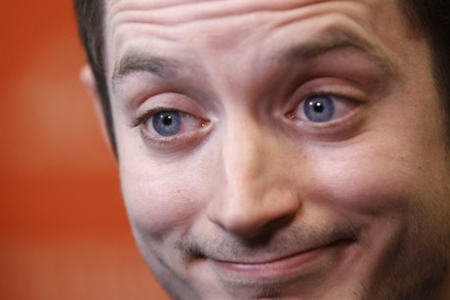 In this Friday, Jan. 20, 2012 file photo, actor Elijah Wood is interviewed at the 2012 Sundance Film Festival in Park City, Utah.