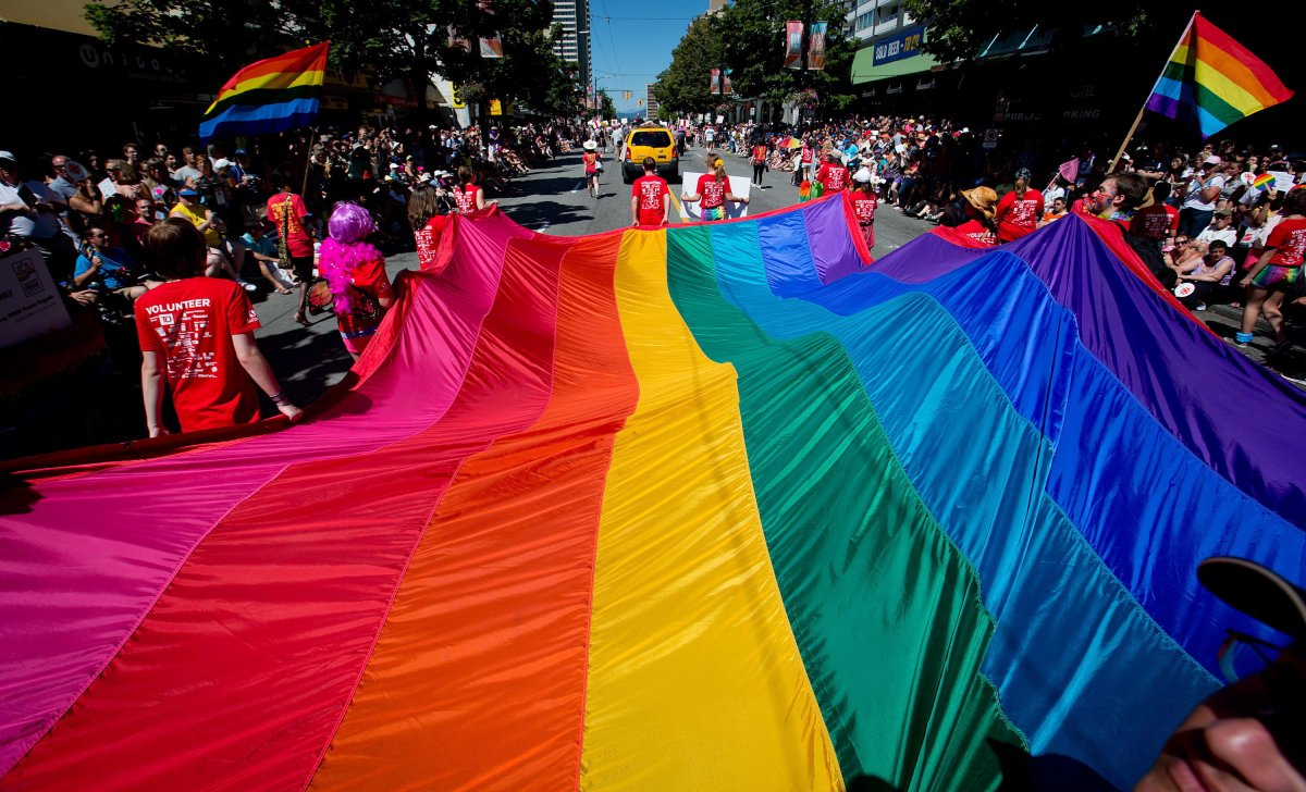 A rainbow flag is held by marchers in the annual Pride parade in Vancouver's West End.