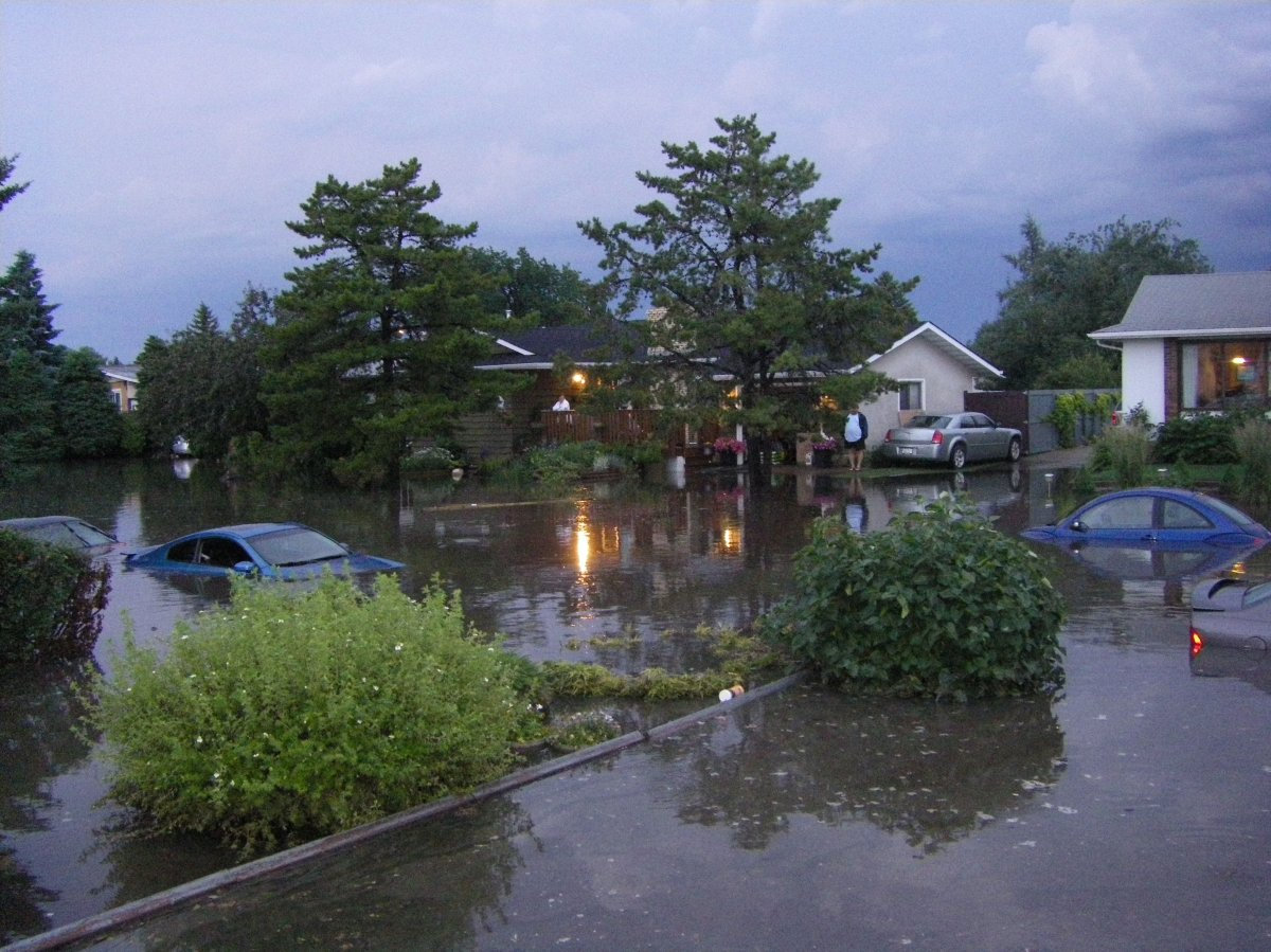 Flooding in Tweddle Place in south-east Edmonton in July 2012.