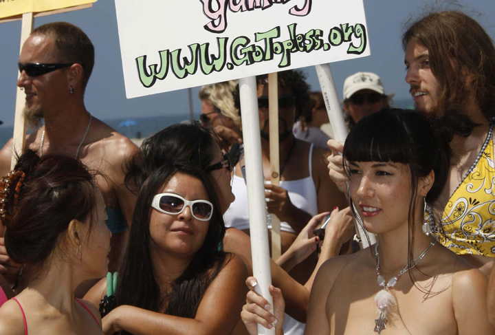Demonstrators take part in Go Topless Day in this file photo.