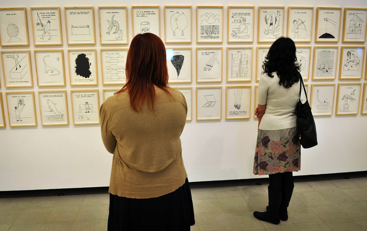 Women browse artworks on display at a press preview of the new exhibition 'Brain Activity' by British Artist David Shrigley at The Hayward Gallery on January 31, 2012 in London, England.