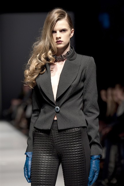 A mdel walks the runway in the Muse by Christian Chenail fall 2013 showcase at Montreal Fashion Week in this undated handout photo.