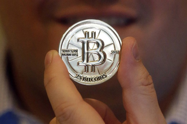 In this April 3, 2013 photo, a 25 Bitcoin token is pictured in Sandy, Utah.