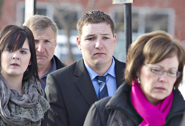 Brenden Holubowich makes his way to the courthouse for sentencing in the deaths of four high school football players, in Grande Prairie Alberta, on Tuesday February 26, 2013.