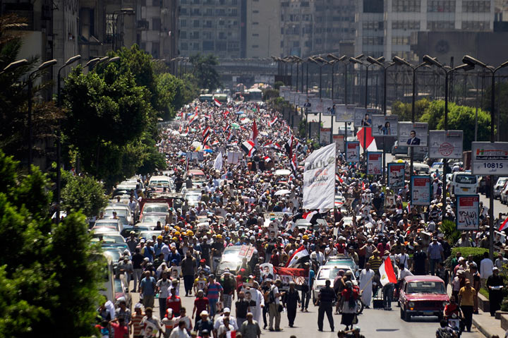 Supporters of ousted Egyptian President Mohamed Morsi take part in a demonstration in support of Morsi in Cairo, on August 9, 2013.