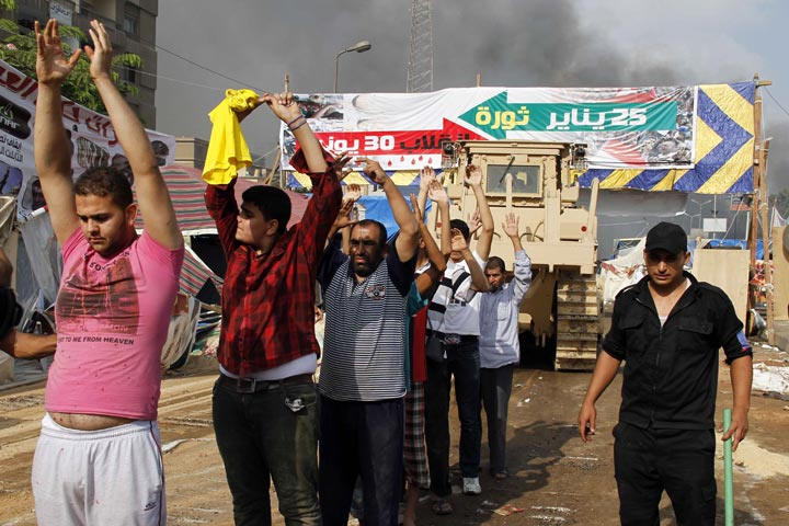 Egyptian security forces detain demonstrators after a crackdown on a protest camp by supporters of ousted president Mohamed Morsi and members of the Muslim Brotherhood on August 14, 2013 in Cairo's Rabaa al-Adawiya mosque.