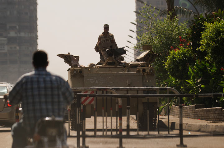 Egyptian soldier keeps watch from the top of an army armoured personnel carrier (APC) at the entrance of Tahrir Square on August 18, 2013 in Cairo.