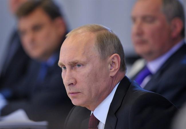 Russian President Vladimir Putin holds a meeting on the development of civil shipbuilding in Russia's fareastern port of Vladivostok, Friday, Aug. 30, 2013.