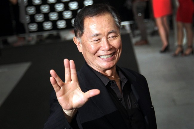 "This May 23, 2013 file photo shows actor George Takei gesturing with a hand greeting made popular by the TV series ""Star Trek"" at the Marina Bay Sands hotel in Singapore."