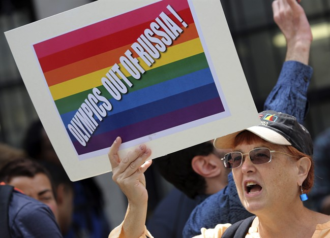 A gay rights activist chant slogans during a demonstration in front of the Russian consulate in New York, Wednesday, July 31, 2013.