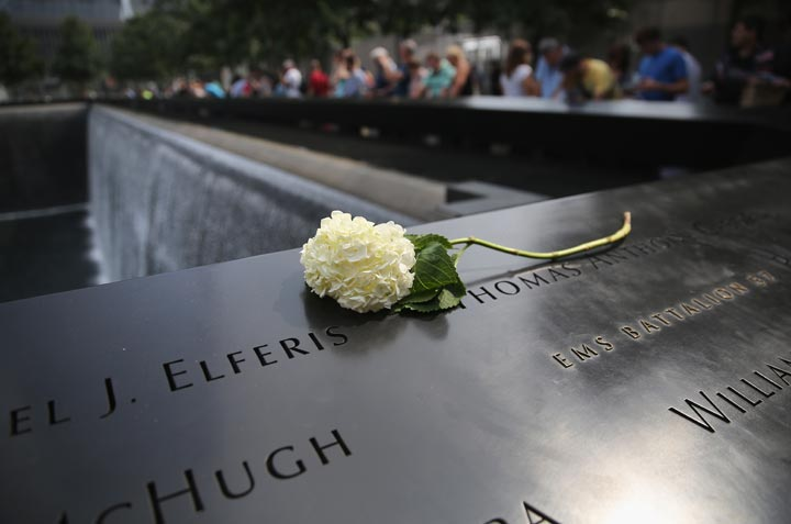 A flower lies atop names of victims at the 9/11 Memorial on September 10, 2013 in New York City.