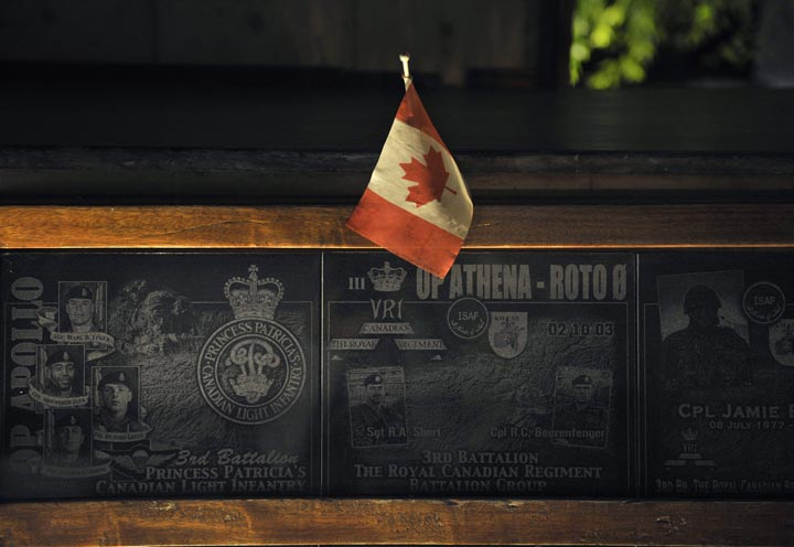 In this photograph taken on July 17, 2011 a Canadian flag is placed on a memorial marker honouring Canadian soldiers who died in combat in Afghanistan erected inside the Canadian forces quarters in Kandahar military base in southern Afghanistan.