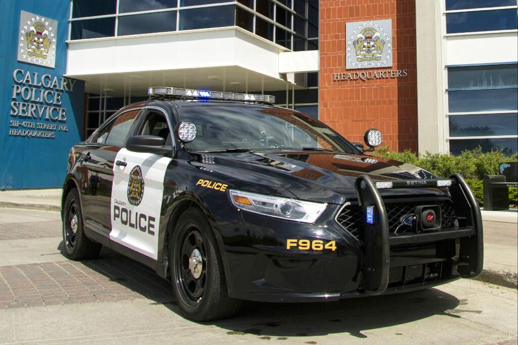 A Calgary Police Service cruiser in front of police headquarters.