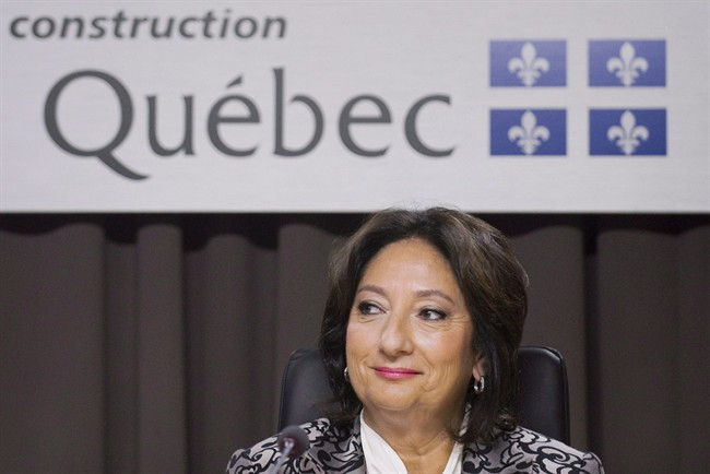 Justice France Charbonneau smiles as she sits on the opening day of a Quebec inquiry looking into allegations of corruption in the province's construction industry in Montreal, Tuesday, May 22, 2012.