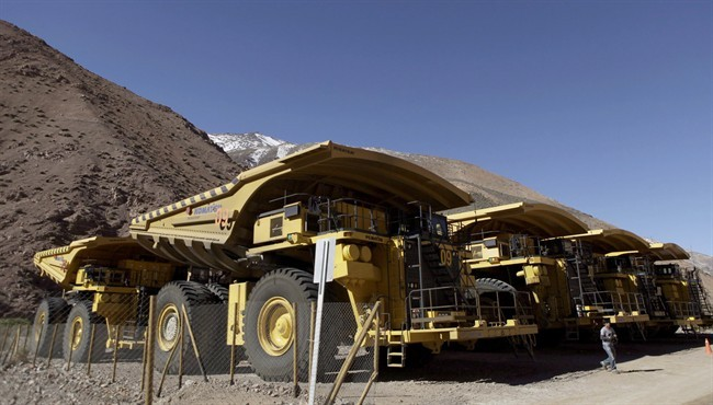 In this May 23, 2013 photo, mining trucks sit parked on the facilities at the Barrick Gold Corp's Pascua-Lama project facilities in northern Chile.